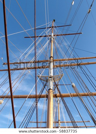 Masted of the C.A Thayer in San Francisco Maritime National Historical Park.  The C.A. Thayer is a schooner built in 1895, now preserved in San Francisco. - stock photo
