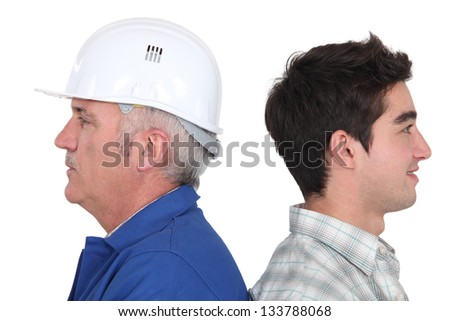 Master and apprentice stood together - stock photo