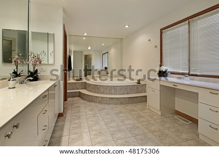 Master bath in home with step up tub