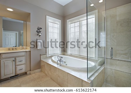 Master bath in luxury home with attached shower and tub.
