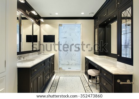 Master bath in luxury home with black cabinetry - stock photo