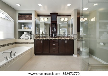 Master bath in luxury home with dark wood cabinetry - stock photo