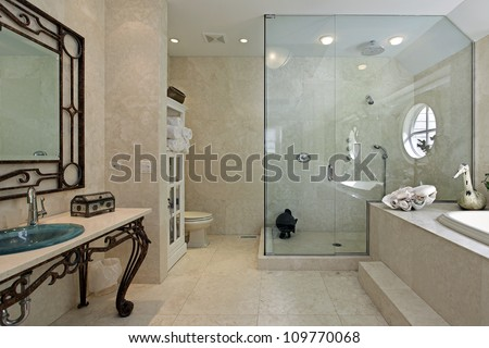 Master bath in luxury home with large step in shower - stock photo