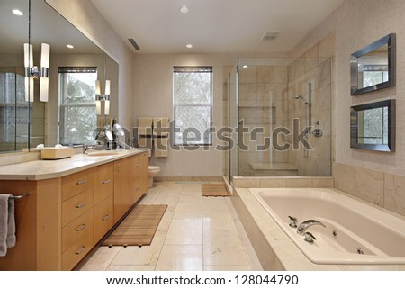 Master bath in luxury home with oak wood cabinetry - stock photo