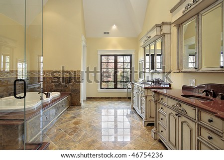Master bath in new construction home with large tub - stock photo