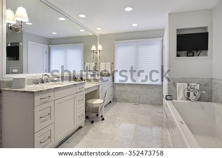Master bath in suburban home with white cabinetry - stock photo