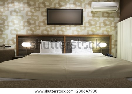 Master bed i modern apartment - stock photo