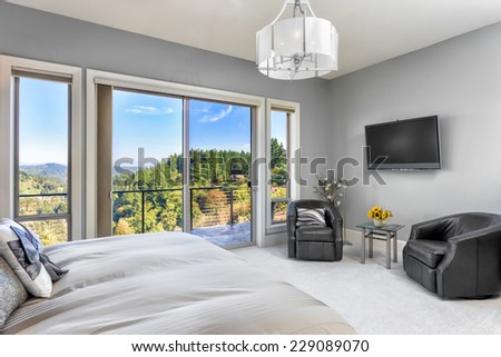 Master Bedroom in Luxury Home with Beautiful View - stock photo