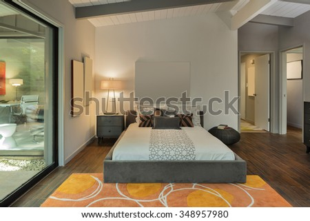 Master Bedroom in Luxury Home with copy space for art work.  - stock photo