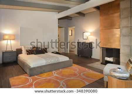Master Bedroom in Luxury Home with fire place and copy space for art work.  - stock photo
