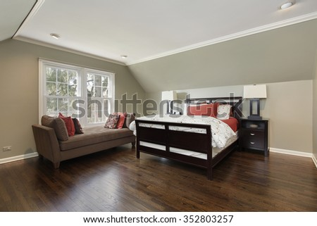 Master bedroom in suburban home with brown sofa