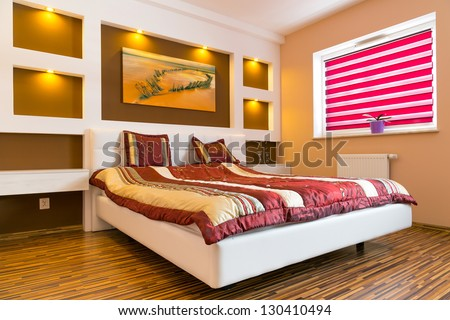 Master bedroom interior with picture of shipwreck on the wall. Photo of shipwreck is available in my gallery. - stock photo