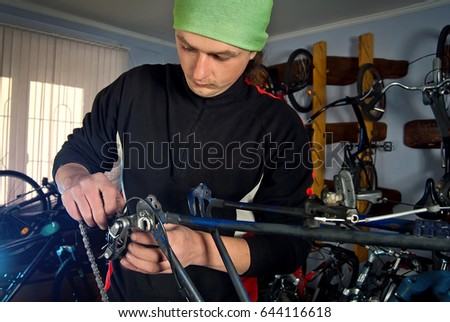Master bike repairs in the workshop with tools in hand