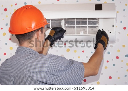 master cleans the air conditioning