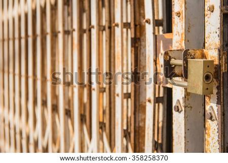 master key on old iron gate background. - stock photo