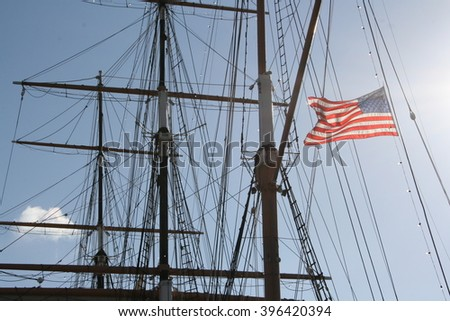Masts and American flag - stock photo