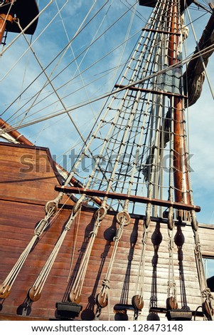 Masts and rigging of a sailing ship - stock photo