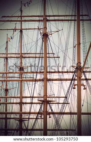 masts of old sailing ship in sepia - stock photo