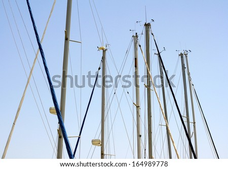 Masts of ships in the sky - stock photo