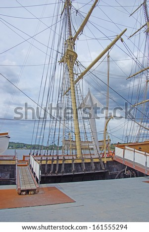 Masts, rigging and yardarms of 19th century sailing ship, Old Mystic Seaport, Connecticut  - stock photo