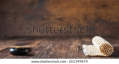 mat for sushi and chopsticks on dark wooden background. Copy space - stock photo