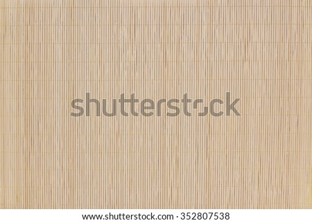 Mat made of wooden sticks texture background. Bamboo mate isolated on white. - stock photo