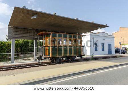 Mata old station wagon and passenger train, called Tren Pinxo Banyoles - stock photo