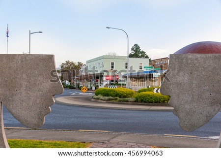 MATAKANA, NEW ZEALAND - JULY 15; street scene intersection of Matakana Valley and Leigh Roads business buildings with silhouette concrete face profiles public art July 15, 2016 Matakana New Zealand