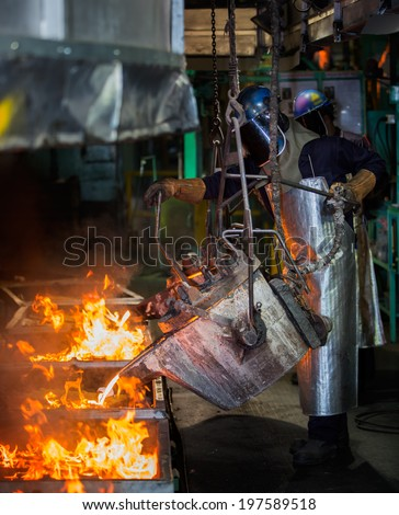 matallurgical production, production of cast iron, metal melting - stock photo