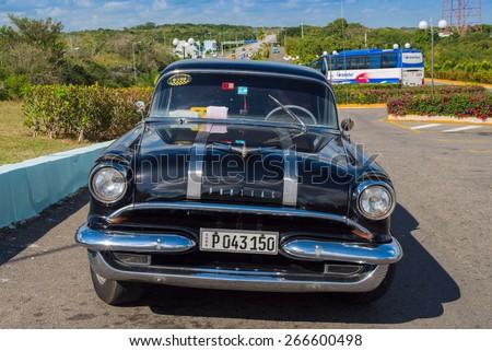 MATANZAS, CUBA - FEB 13: Old American car on a parking lot beside a freeway to Havana in Mazantas, Cuba on Feb. 13, 2015 - stock photo