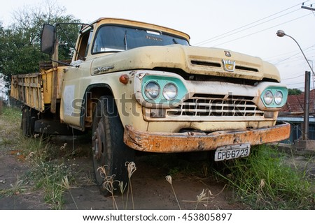 Matao, SP, Brazil - June 25, 2011. Front of a rusty and old yellow ford.