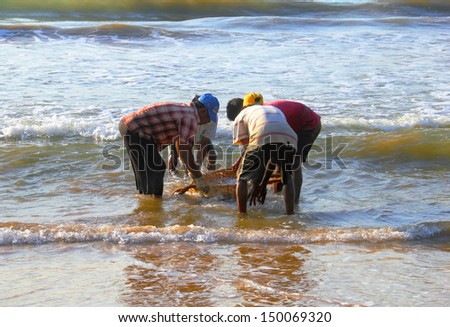 MATARA/SRI LANKA - FEBRUARY 10. Fishing on February 10, 2013 in Matara, Sri Lanka. Fishermen get fish an Indian ocean. - stock photo