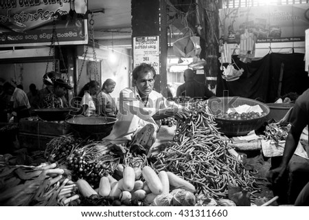 MATARA, SRI LANKA - MARCH 27, 2016: people buy products at the local fruit and vegetable markets. Also on the market you can buy fresh fish and seafood.