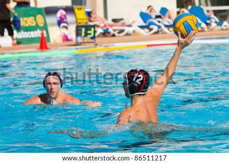 MATARO, SPAIN - OCTOBER 12: David Gonzalez (12) of Terrassa in action during the water polo Spanish League match between Mataro and CN Terrassa, 7-6, on October 12, 2011, in Mataro, Barcelona, Spain.