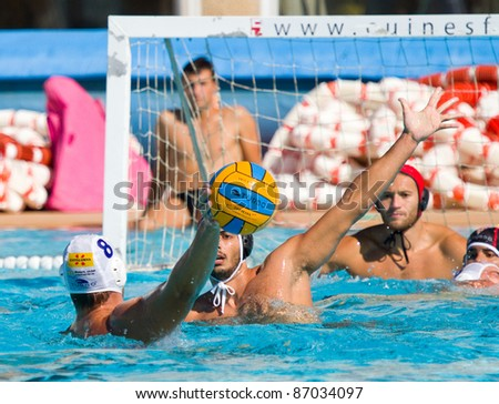 MATARO, SPAIN - OCTOBER 12: Unidentified players in action during the water polo Spanish League match between Mataro and Terrassa, final score 7-6, on October 12, 2011, in Mataro, Barcelona, Spain.