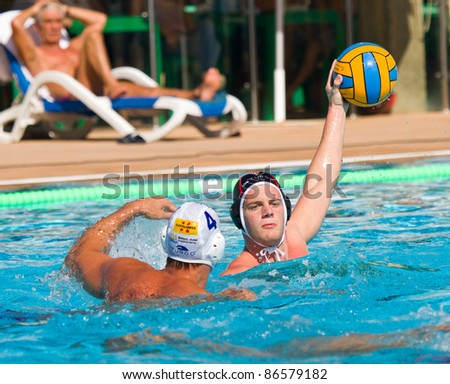 MATARO, SPAIN - OCTOBER 12: Victor Cabanas (R) of Terrassa in action during the water polo Spanish League match between Mataro and CN Terrassa, 7-6, on October 12, 2011, in Mataro, Barcelona, Spain.
