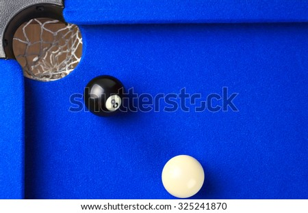 Match ball. Black eight ball in the pocket.