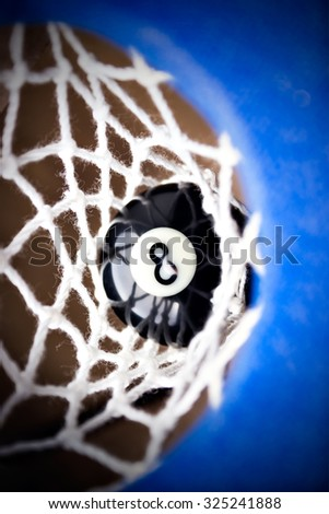 Match ball. Black eight ball in the pocket. - stock photo