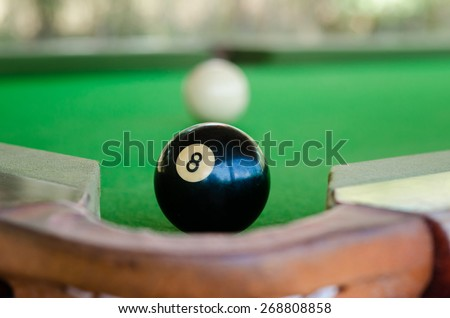 Match ball. Black eight ball to the pocket