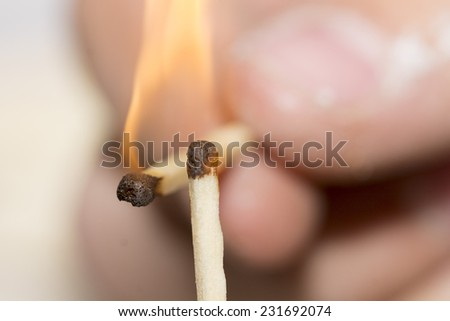 match burning on a hand close-up - stock photo