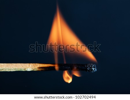 Match burning with a bright yellow flame till it dies - stock photo