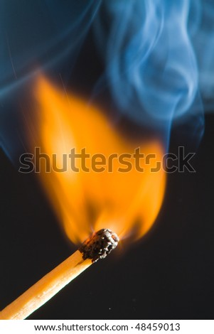Match flame with smoke and black background - stock photo