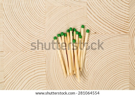 match lying on the surface of laminated wood - stock photo