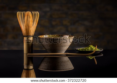 Matcha fine powdered green tea on black background - stock photo