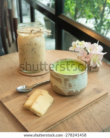 Matcha Green Tea and cookie on wooden tray.And ice coffee on the wooden table  - stock photo