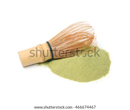Matcha green tea powder with bamboo whisk isolated on white background.