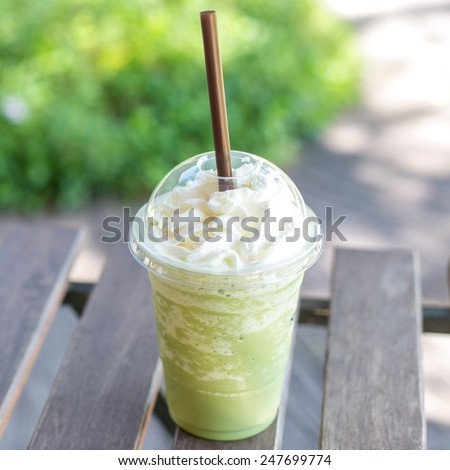 matcha green tea smoothie whipped cream - stock photo