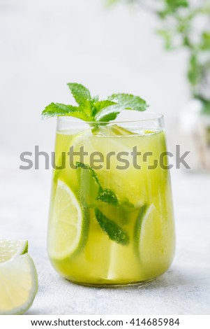 Matcha iced green tea with lime and fresh mint on a marble background - stock photo