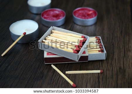 Matchbox and candles