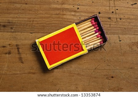 Matchbox on old table. - stock photo